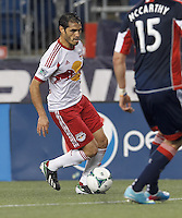 New York Red Bulls forward Fabian Espindola (9) dribbles. In a Major League Soccer (MLS) match, the New England Revolution (blue) tied New York Red Bulls (white), 1-1, at Gillette Stadium on May 11, 2013.