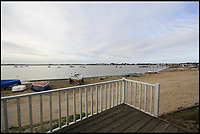 BNPS.co.uk (01202 558833)<br /> Pic: Denisons/BNPS<br /> <br /> Sold for &pound;275,000...<br /> <br /> A beach hut on a sandy spit has sold for a whopping &pound;275,000 - and it doesn't even face the sea.<br /> <br /> The small timber cabin can only be slept in for part of the year and the new owners will have to share communal bathroom facilities.<br /> <br /> But the sky-high price tag is down to its location on the exclusive Mudeford Spit in Christchurch, Dorset, which is home to the most expensive beach huts in the country.<br /> <br /> The agents have another hut for sale for &pound;250,000 which is on the beach side of the spit. It also sleeps four to six people and has a mezzanine floor, kitchen area and sun deck.