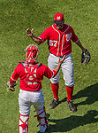 26 April 2014: Washington Nationals pitcher Tanner Roark is congratulated by catcher Sandy Leon after a matchup against the San Diego Padres at Nationals Park in Washington, DC. Roark pitched his first complete MLB game, a 3-hit shutout, as the Nationals defeated the Padres 4-0 to take the third game of their 4-game series. Mandatory Credit: Ed Wolfstein Photo *** RAW (NEF) Image File Available ***