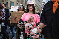 NEW YORK, NY - JANUARY 21: A girl holds two baby dolls during  the Women's March in New York City on January 21, 2017. Protesters in the United States and around the world are joining marches Saturday to raise awareness of women's rights and other civil rights they fear could be under threat under Donald Trump's presidency. Photo by VIEWpress/Maite H. Mateo.