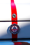 Sept. 15, 2012 - New Hyde Park, New York, U.S. -  A closeup of Cobra emblem and lock of Mustang GT350, red with white stripes, that is at the New York AutoFest at New Hyde Park Car Show and Street Fair.