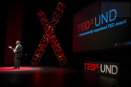 Jan. 20, 2014; Emcee and Vice President and Associate Provost for Undergraduate Affairs; Dean of First Year of Studies, Hugh R. Page, introduces the next speaker at the TEDxUND 2014 event in the Debartolo Performing Arts Center. Photo by Barbara Johnston/University Photographer