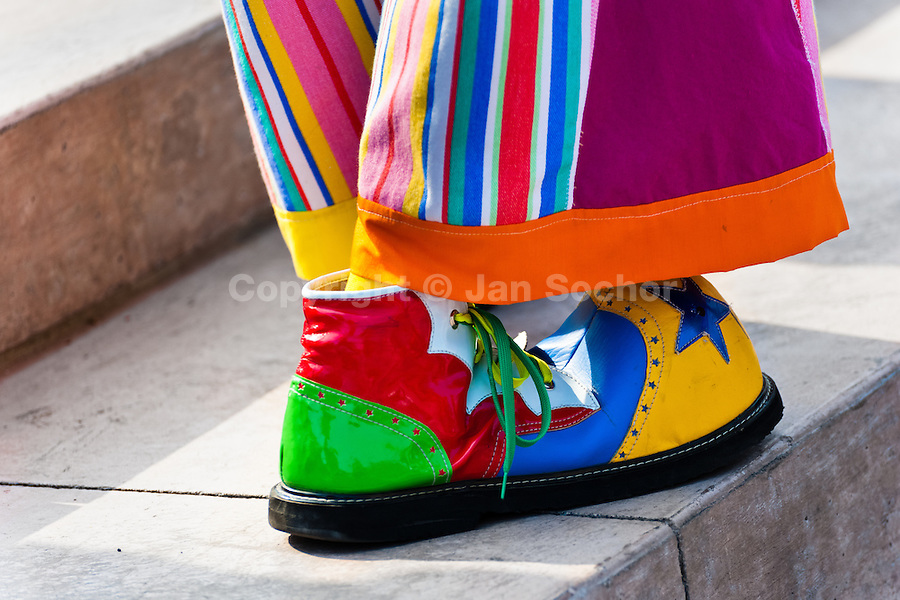 A clown wears oversized colorful shoes and pants during the Clown Congress in San Salvador, El Salvador, 18 May 2011. The clown performance is considered a regular job in most of Latin American countries. Clowns may work individually or in groups, often performing advertisement like acts in large open-to-street shops or they take part in private shows, like children birthdays, family events etc. There are many clown conventions all over Latin America where clowns gather and exchange their experiences offering workshops of the comic acting or the art of make-up. For some of them, being clown is a serious lifetime profession.