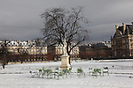 Paris, France , and continental Europe is gripped by heavy snow and arctic conditions in the run up to Christmas December 2010. Transport is just about brought to a standstill, with airports and train stations closed down or running slow. On the other hand Paris is rarely snowbound and as such  is idyllic and remains an attraction to tourists and local Parisiens alike.//Empty chairs and snow covered statue in Paris Tulieries park and gardens in the snow