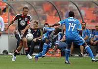 WASHINGTON, D.C. - AUGUST 19, 2012:  Nick DeLeon (18) of DC United gets the ball away from Michael Lahoud (13) of the Philadelphia Union during an MLS match at RFK Stadium, in Washington DC, on August 19. The game ended in a 1-1 tie.