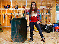 NWA Democrat-Gazette/DAVID GOTTSCHALK   Destiny Schlinker, program manager for Apple Seeds Inc., poses for a portrait Wednesday, May 25, 2016, in the barn as she describes  the operation of the teaching farm in Fayetteville.