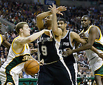 Seattle SuperSonics Luke Ridnour (L) knocks the ball away from Tony Parker of France (M) as he drives to the basket in the first period of their Western Conference Semifinals Game 6 at Key Arena in Seattle, Washington on Thursday 19 May 2005. Watching are Spurs Tim Duncan ,21, and SuperSonics Jerome James.  . Jim Bryant Photo. &copy;2010. All Rights Reserved.