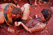 A Spanish couple fights in tomato pulp during La Tomatina festival in Bunol, Spain, 31 August 2006. La Tomatina is a tomato fight held annually in the town of Bunol, close to Valencia. Approximately 40,000 people from all over the world arrive to fight in the battle in which about 50 tons of over-ripe tomatoes are thrown in the street. During the one hour battle everybody fights everybody by throwing squashed tomatoes. The origin of this event is unknown but the Tomatina fights have been recorded since 1945.