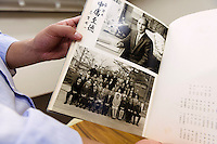 An old and unfaded photo album printed by the collotype process. Benrido collotype atelier, Kyoto, Japan, October 9, 2015. The Benrido collotype atelier in Kyoto was founded in 1887 and is the only full-scale commercial collotype atelier in the world. Collotype is a historic photographic printing process that makes use of plates coated in gelatine. It produces prints of unrivalled quality.