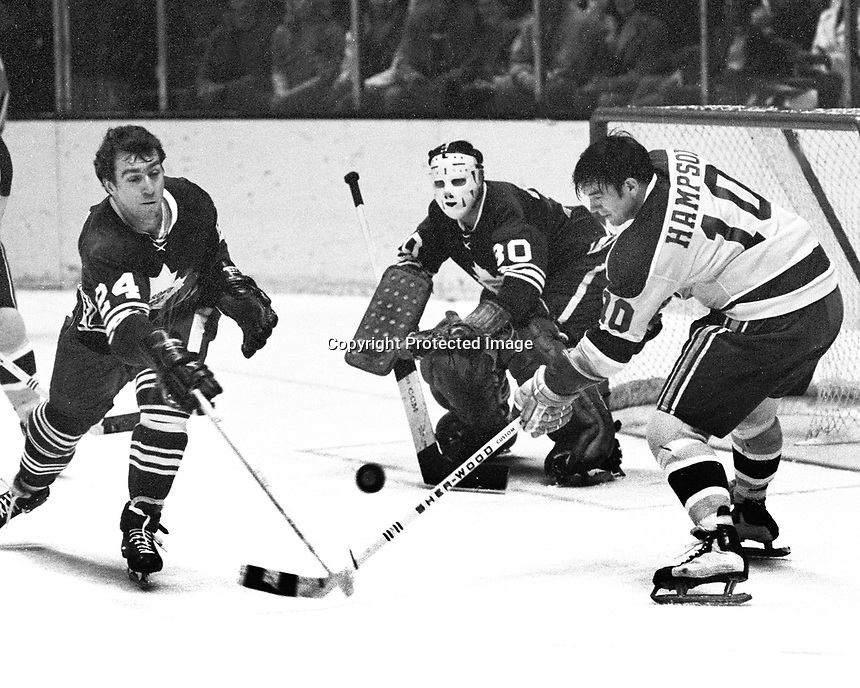 Seals vs Maple Leafs: Seals Ted Hampson tries to score against Brian Glennie and goalie Bruce Gamble..1970 photo/Ron Riesterer