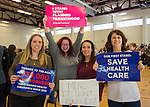 "Westbury, New York, USA. January 15, 2017. L-R, SUE MOLLER of Merrick, AMY BUDD of Bellmore, STEFANA MULLER of Babylon, and BETH MCMANUS of Seaford, the Administrators of Together We Will Long Island, TWWLI, are holding protest signs at the ""Our First Stand"" Rally against Republicans repealing the Affordable Care Act, ACA, taking millions of people off health insurance, making massive cuts to Medicaid, and defunding Planned Parenthood. It was one of dozens of nationwide Bernie Sanders' rallies for health care that Sunday."