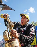 Aug 21, 2016; Brainerd, MN, USA; NHRA pro stock driver Drew Skillman celebrates after winning the Lucas Oil Nationals at Brainerd International Raceway. Mandatory Credit: Mark J. Rebilas-USA TODAY Sports