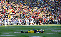 Michigan Wolverines quarterback Devin Gardner (98) lays on the ground after throwing an interception to Ohio State Buckeyes defensive back Tyvis Powell (23)(not in photo) during a two-point conversion in the 4th quarter during their college football game at Michigan Stadium in Ann Arbor, Michigan on November 30, 2013.  (Dispatch photo by Kyle Robertson)