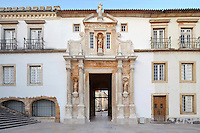 Library building with Porta Ferrea seen on the interior facade, designed 1634 by Antonio Tavares, at the University of Coimbra in the former Palace of the Alcazaba, Coimbra, Portugal. The Porta Ferrea is decorated with a statues by Manuel de Sousa of Wisdom, symbol of the University, and on either side, King John III or Joao III and King Denis I, founder of the University. The University of Coimbra was first founded in 1290 and moved to Coimbra in 1308 and to the royal palace in 1537. The buildings are listed as a historic monument and a UNESCO World Heritage Site. Picture by Manuel Cohen