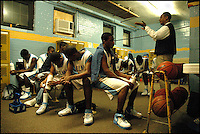 Coach Herman Turner gives a pep talk to the Selma High School basketball team, the Saints, in the locker room at half time on Friday.  The Saints lost to the Tigers 62-53.