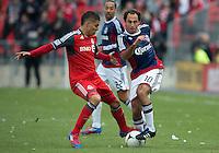 14 April 2012: Chivas USA midfielder Nick LaBrocca #10 and Toronto FC midfielder Luis Silva #11in action during the first half in a game between Chivas USA and Toronto FC at BMO Field in Toronto.