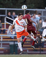 Syracuse University forward Grant Chong (27) and Boston College forward/midfielder Diego Medina-Mendez (11) battle for head ball. Boston College (maroon) defeated Syracuse University (white/orange), 3-2, at Newton Campus Field, on October 8, 2013.