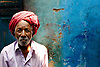 Old man seated in front of his house in Dharavi slum, Mumbai