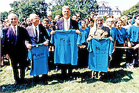 "Israeli Foreign Minister Shimon Peres, left, Israeli Prime Minister Yitzhak Rabin, left center, United States President Bill Clinton, center, and Palestine Liberation Organization Chairman Yasser Arafat, right, pose holding t-shirts of ""Seeds of Peace"" after they signed the Oslo 1 Accords on the South Lawn of theWhite House on September 13, 1993.  The 47 ""Seeds of Peace"" boys came from Israel, Egypt, and the Palestinian Territories and were the honored guests for the signing ceremony.  John Wallach, President and Founder of ""Seeds of Peace"" can be seen to the immediate left behind Prime Minister Rabin. .Mandatory Credit: Bob McNeely - White House via CNP /MediaPunch"