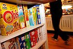 PHILADELPHIA - DECEMBER 1: A customer walks past boxes of cereal at Cereality Cereal Bar and Cafe December 1, 2004 in Philadelphia, Pennsylvania. Cereality sells almost any cereal imaginable near the University of Pennsylvania campus in their first full fledged store. (Photo by William Thomas Cain/Getty Images)
