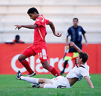 Daniel Stanese (5) of Canada tries to tackle the ball away from Jorman Aguilar (18) of Panama during the semifinals of the CONCACAF Men's Under 17 Championship at Catherine Hall Stadium in Montego Bay, Jamaica. Canada defeated Panama, 1-0.
