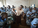 Sister Maria Goretti Namono leads students in singing at the John Paul II School in Wau, South Sudan. Namono is the school's project manager for the full inclusion of girls. From Uganda, she is a member of the Franciscan Missionary Sisters for Africa.
