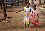 Two girls dressed up for Sunday worship in a Catholic training center in Niamana, Mali. Several families displaced by the fighting in northern Mali took refuge in the center, and have received support from the ACT Alliance.