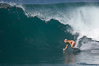LEE ANN CURREN (FRA)  the daughter of two times world surfing champion TOM CURREN (USA),  surfing Off The Wall-Backdoor, North Shore of Oahu, Hawaii. Photo: joliphotos.com