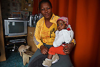 13 May 2011, Teyateyaneng, Berea District, Lesotho. mothers2mothers is an organisation that functions within the existing heatlhcare system, that train and employ mothers with HIV to educate and support their peers. One of their success stories, is the case of the Nkesana Family. When father Lehlohonolo discovered he was HIV-positive, he convinced his wife, Qenehelo, to go for a test. The shock was devastating for the parents of 2 boys (negative) but they went for counseling and support at M2M. Careful planning resulted them conceiving a healthy baby girl, Malehlohonolo, who at 1 year is now still HIV-negative.