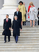 Washington, DC - January 20, 2009 -- United States President Barack Obama (L) walks with Former President George W. Bush (R) as they are followed by Vice President Joe Biden (C) and first lady Michelle Obama (in yellow) and former first lady Laura Bush (R)  on the East Front of the US Capitol Building after Barack Obama was sworn in as the 44th President of the United States in Washington, DC, USA 20 January 2009.  Obama defeated Republican candidate John McCain on Election Day 04 November 2008 to become the next U.S. President..Credit: Tannen Maury - Pool via CNP