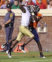 Sept. 3, 2011 - Charlottesville, Virginia - USA; Virginia Cavaliers wide receiver Tim Smith (20) hauls in a pass around William & Mary Tribe cornerback B.W. Webb (2) during an NCAA football game at Scott Stadium. Virginia won 40-3. (Credit Image: © Andrew Shurtleff