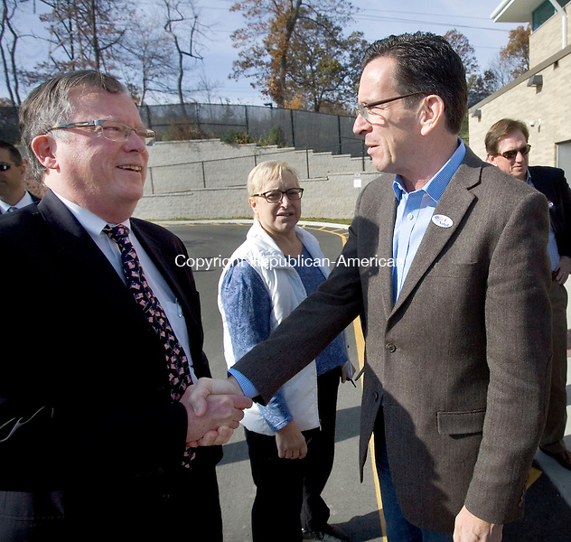 WATERBURY CT. 04 November 2014-110414SV01-Kevin Brennan, principal of Carrington School, greets Governor Dannel P. Malloy when the Governor stopped by the school to campaign in Waterbury Tuesday. <br /> Steven Valenti Republican-American