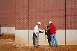 Kenny Harrison (left) is the Fire Safety Program Manager at Auburn University in Auburn, Alabama. He conducts an inspection of the construction of the school's new basketball arena with Dustin Ranger, Assistant Superintendent for Robins and Morton, November 18, 2009.