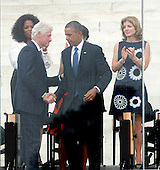 Former United States President Bill Clinton shakes hands with U.S. President Barack Obama as Oprah Winfrey and Ambassador Caroline Kennedy look on following Obama's remarks at the Let Freedom Ring ceremony on the steps of the Lincoln Memorial to commemorate the 50th Anniversary of the March on Washington for Jobs and Freedom<br /> Credit: Ron Sachs / CNP