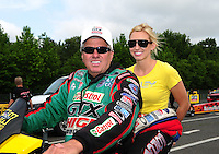 Jun. 1, 2012; Englishtown, NJ, USA: NHRA funny car driver John Force (left) with daughter Courtney Force during qualifying for the Supernationals at Raceway Park. Mandatory Credit: Mark J. Rebilas-