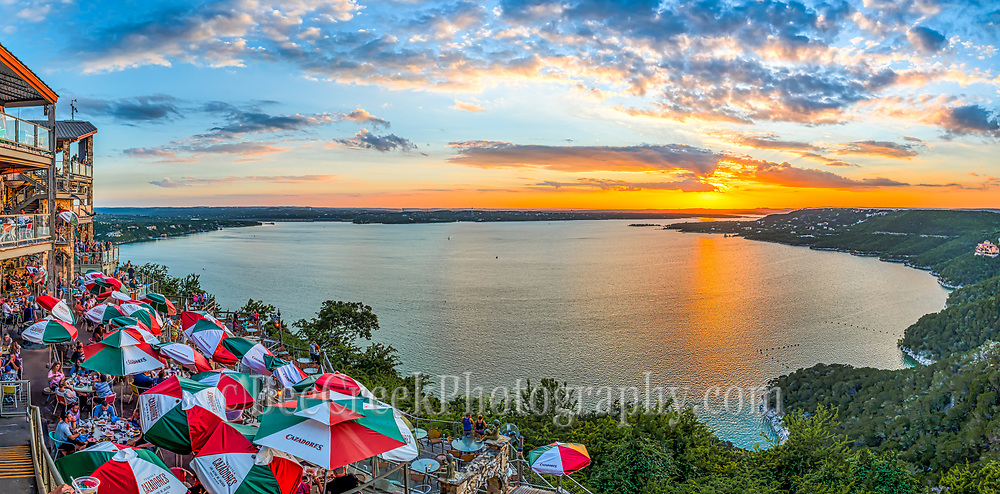 One more image of this wonderful sunset at the Oasis on Lake Travis.  Lake Travis is outside of Austin, Texas in the Hill Country which is a favorite place for locals and tourist to come and you can't miss the Oasis restaurant for some good food and drinks as you watch the sunset set.  Love that the sunset was almost here and they still have the umbrellas up.