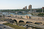 Minnesota, Twin Cities, Minneapolis-Saint Paul: Stone Arch Bridge crosses Mississippi at Minneapolis.  Former railroad bridge now used for recreation. .Photo mnqual262-75342..Photo copyright Lee Foster, www.fostertravel.com, 510-549-2202, lee@fostertravel.com.