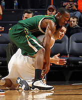 Dec. 20, 2010; Charlottesville, VA, USA; Virginia Cavaliers guard Jontel Evans (1) calls a time out while chasing after a loose ball with Norfolk State Spartans guard/forward Rob Hampton (1) during the game at the John Paul Jones Arena. Mandatory Credit: Andrew Shurtleff