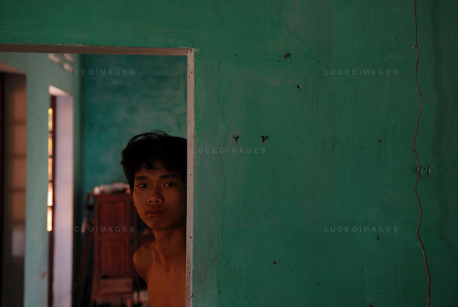 A Vietnamese boy in his home in Hoi An, Vietnam.