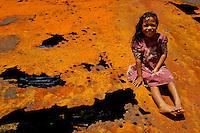 Girl on rusty IIWW landing craft