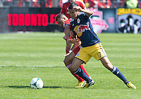 April 27, 2013: New York Red Bulls midfielder Tim Cahill #17 and Toronto FC midfielder John Bostock #7 in action during a game between Toronto FC and the New York Red Bulls at BMO Field  in Toronto, Ontario Canada..The New York Red Bulls won 2-1.