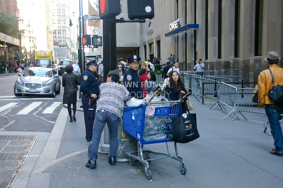 Man digs for cans outside JP Morgan Chase Bank during the Occupy Wall Street Protest in New York City October 6, 2011.