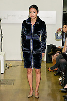 85 Broads member walks runway in an FW11 blue faux fur coat by Yuna Yang, during the 85 Broads Presents Yuna Yang trunk show at Art Gate Gallery on October 24th 2011.