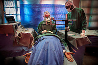 Ophthalmologist Doctor Richard Hardi carries out a cataract operation in the remote village of Pania in a room that his team has transformed into an operating theatre. <br /> <br /> From his base in Mbuji Mayi Hungarian ophthalmologist Friar Richard Hardi and his team travelled deep into the Congolese rainforest, by 4x4 and canoe, to treat people in isolated communities most of whom have never seen an ophthalmologist. At a small village called Pania they established a temporary field hospital and over the next three days made hundreds of consultations. Although both conditions are preventable, many of the patients they saw had Glaucoma or River Blindness (onchocerciasis) that had permanently damaged their eyesight. However, patients with cataracts, a clouding of the eye's lens, who were suitable for treatment were booked for an operation. For two days the team carried out the ten minute procedure on one patient after another. The surgery involves making a 2.2mm incision into the remove the damaged lens that is then replaced by an artificial one. Doctor Hardi is one of the few people willing to make such a journey but is inspired to do so by his faith and, as he says: 'Here I feel that I can really make a difference in people's lives'. /Felix Features