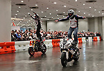 Red bull pilots ride a motorcycle during the International motorcycle show in New York, United States. 18/12/2013. Photo by Kena Betancur/VIEWpress.