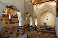 General view of Sant Joan de Boi church, 1123, consecrated by Ramon Guillem, the bishop of Roda, Taull, Province of Lleida, Catalonia, Spain. It is a basilica with three naves with a central wooden gable roof apse and two small semi-circular apses. Mural paintings decorate the interior of the naves with scenes such as The Stoning of Saint Stephen, The Minstrels and The Bestiary. All paintings were taken to the MNAC (National Art Museum of Catalonia, Barcelona) in 1922. The church is one of the best examples of Romanesque architecture. Sant Joan de Boi church is part of the Catalan Romanesque churches of the Vall de Boí which were declared a World Heritage Site by UNESCO in November 2000. Picture by Manuel Cohen.