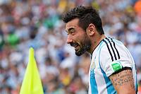 Ezequiel Lavezzi of Argentina winces