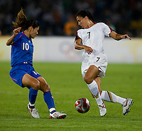 USWNT midfielder (7) Shannon Boxx (7) tries to move past Japanese captain (10) Homare Sawa while playing at Worker's Stadium.  The USWNT defeated Japan, 4-2, during the semi-finals of the Beijing 2008 Olympics in Beijing, China.