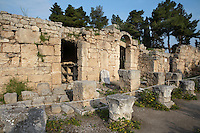 CORINTH, GREECE - APRIL 16 : A view from the side of the West Shops, on April 16, 2007 in Corinth, Greece. A row of shops, seen here in the early morning light, forms the west side of the forum. There is an entrance to the Forum through the middle of the row. An inscription on one of the shops refers to repairs after earthquake damage in 375 AD. Corinth, founded in Neolithic times, was a major Ancient Greek city, until it was razed by the Romans in 146 BC. Rebuilt a century later it was destroyed by an earthquake in Byzantine times. (Photo by Manuel Cohen)
