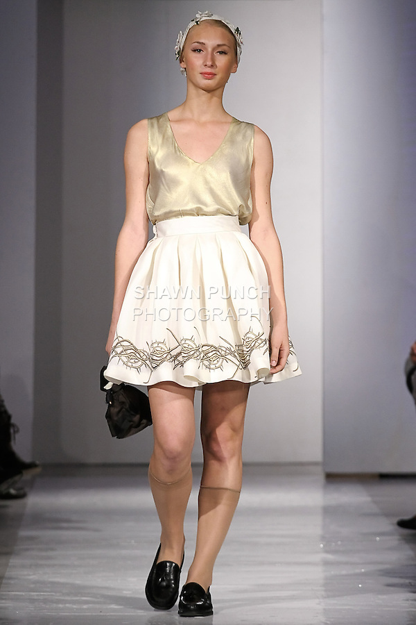 Model walks the runway in an outfit by Kaylin Marie Andres, for the Kaylin Andres runway show, during BK Fashion Weekend Spring Summer 2012.